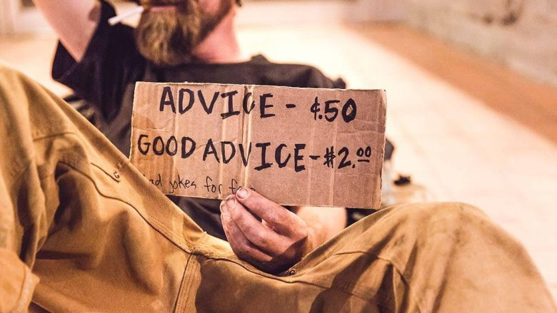 A man with a cardbox sign, giving advice and telling you, you can become anything you want