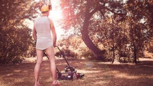 A man in his underwear mowing the lawn, all for the sake of hustle