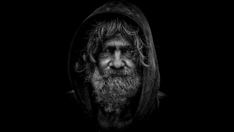 An old man in a black and white head shot, that has walked through the process of life