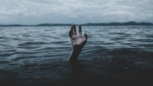 A hand reaching out of the water, in search of its full potential