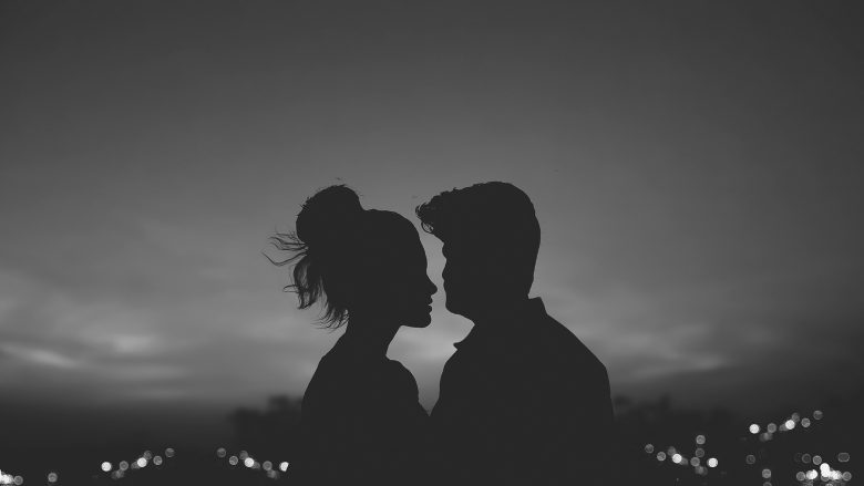 A man and woman kissing, because they are in love